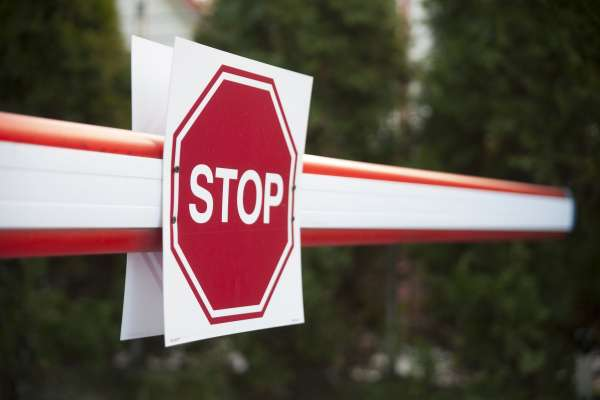 Barrier and Stop Sign